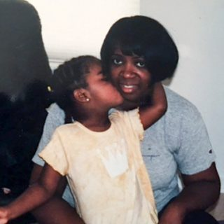 Jada as a child with her mom, Melina.