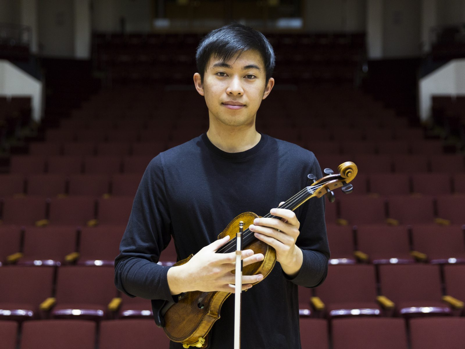 Luke Valmadrid poses with his violen