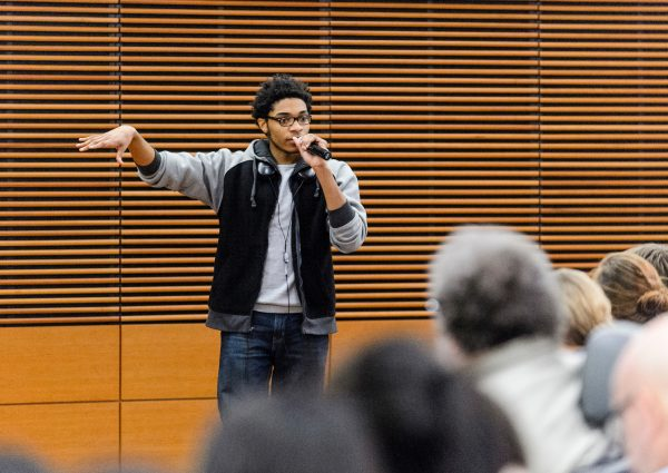 UW student Deshawn McKinney speaks during a public roundtable discussion titled