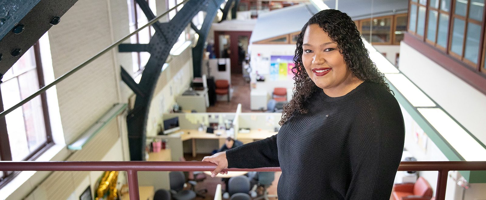 Abagail Catani poses for a portrait in UW–Madison's Red Gym and Multicultural Student Center.