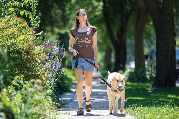 Carmen Nightfall walking her dog on a sunny summer day.