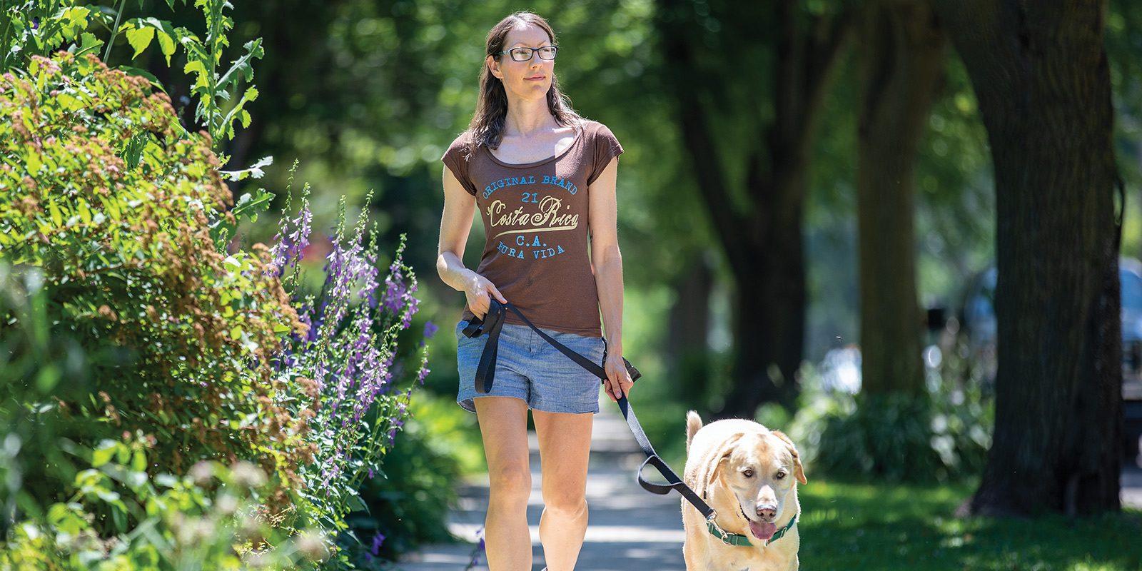 Carmen Nightfall walking her dog on a sunny summer day.