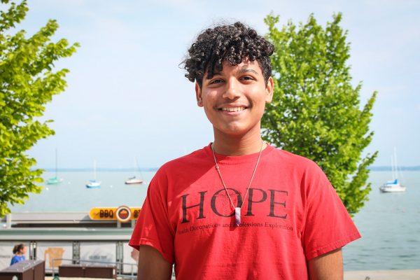 Yanci Almonte Vargas standing in front of Lake Mendota.