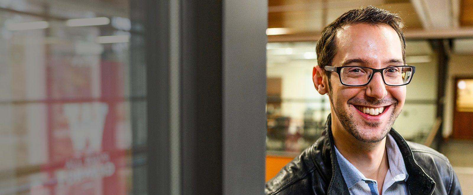 Brett Nachman poses in the Education Building.